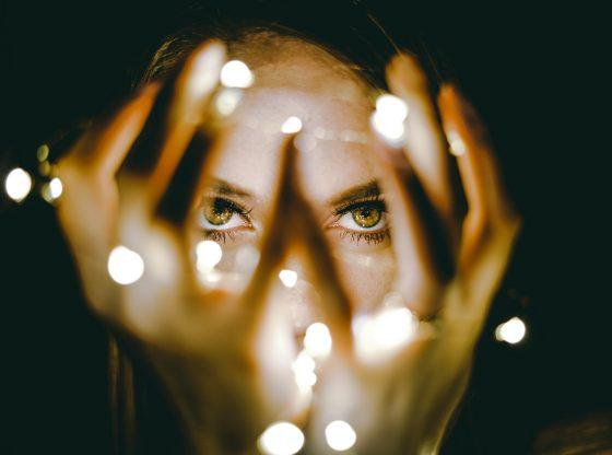 womans eyes between lights