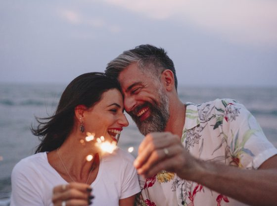 couple with sparklers at the beach