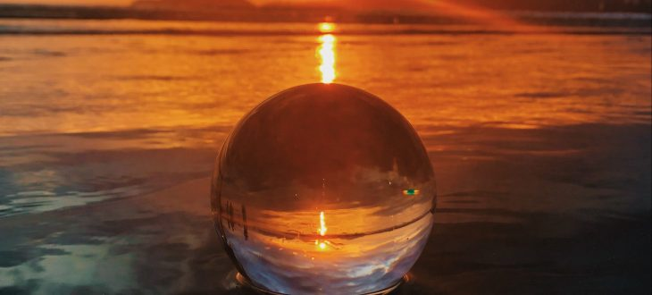 crystal ball in the water at sunset