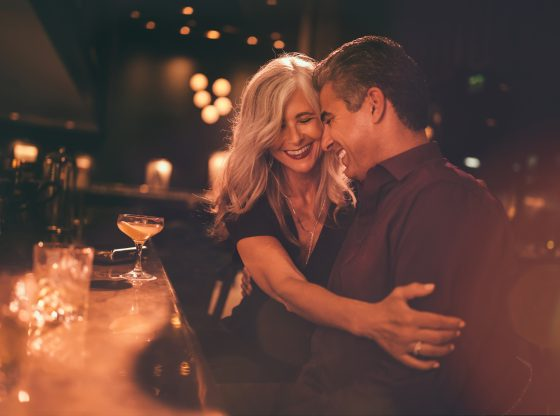 Elegant mature couple having fun on romantic date at bar