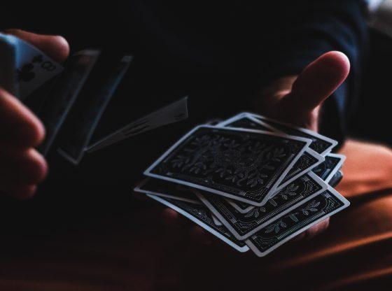 hands shuffling tarot cards